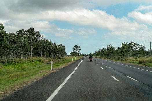Motorcyclist Riding On A Country Highway