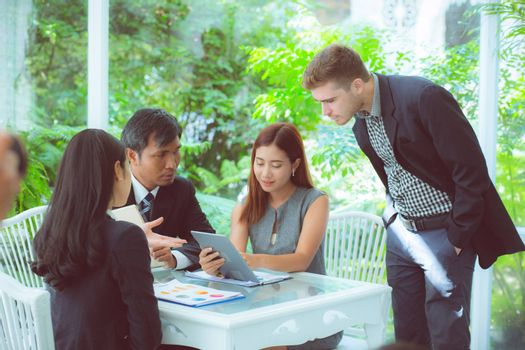 young business people making meeting and talking for analyzing marketing working at office on desk.
