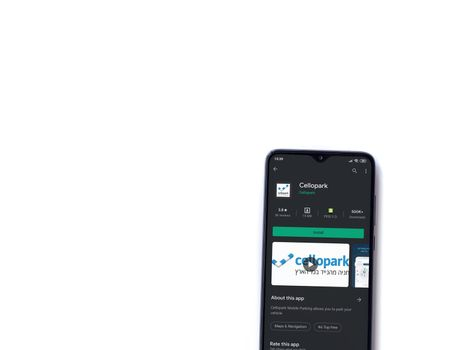 Lod, Israel - July 8, 2020: Cellopark app play store page on the display of a black mobile smartphone isolated on white background. Top view flat lay with copy space.
