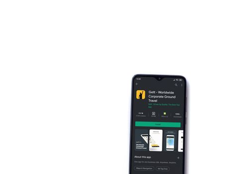 Lod, Israel - July 8, 2020: Gett app play store page on the display of a black mobile smartphone isolated on white background. Top view flat lay with copy space.
