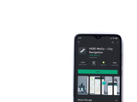 Lod, Israel - July 8, 2020: HERE WeGo app play store page on the display of a black mobile smartphone isolated on white background. Top view flat lay with copy space.