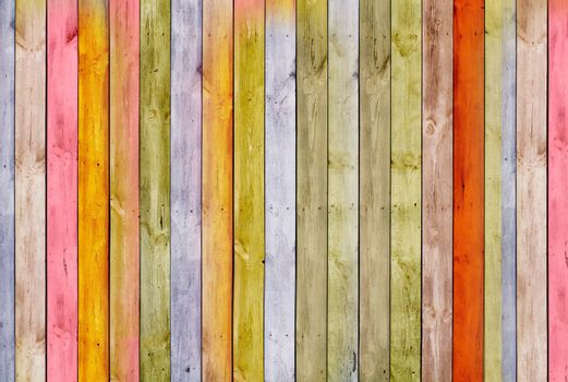 The wall is made of pine multi-color wooden Board. Texture or background