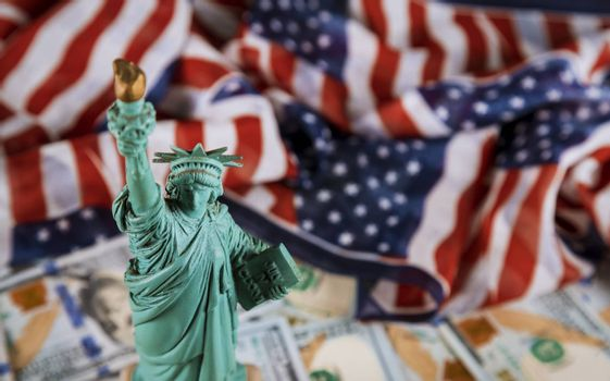 The Statue of Liberty the United States a symbol of freedom and democracy with flag of the United States of America US dollar bills