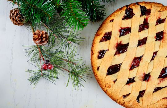 New Year delicious dessert apple cake tart and fir tree of christmas