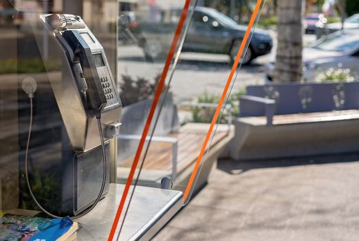 Obsolete Payphone On City Street