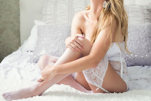Young Woman In Boudoir Pose On Bed