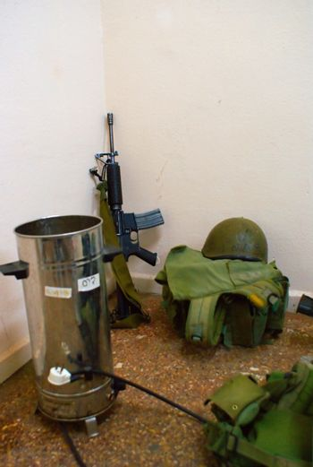 Soldiers room rifle and  boots