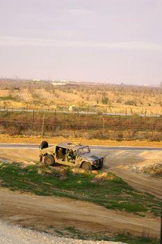 Israel army patrol jeep near gaza border