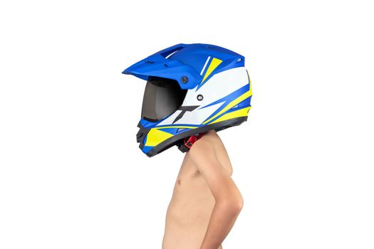 A boy wearing a motocross helmet standing but without a shirt isolated on white background.