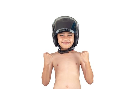 A boy wearing a motorcycle helmet stands smiling but without a shirt isolated on white background.
