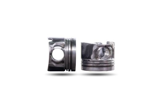 Parts of car piston isolated on white background, Automotive industry and garage concepts.