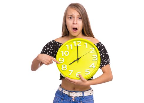 Surprised Teen Girl holding Big Clock, isolated on white background. Portrait of teenager showing big clock with Stress. Shocked Child back to school.