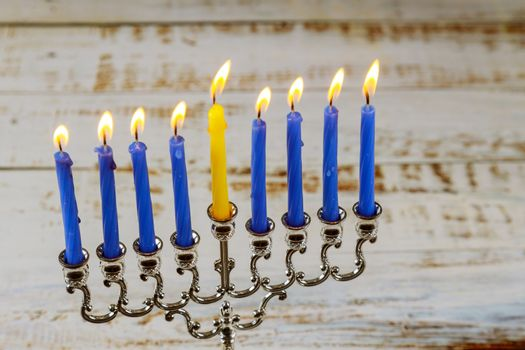 Hebrew Menorah of Hanukkah with burning candles is traditional symbol for Jewish holiday