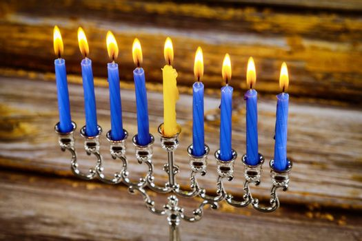 Menorah of Hanukkah with burning candles is Jewish holiday for traditional symbol