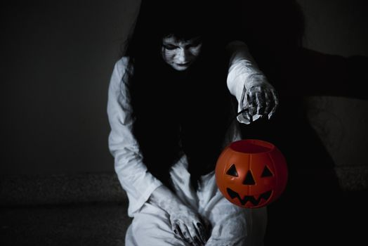 Woman ghost horror have hand holding her pumpkin, halloween concept