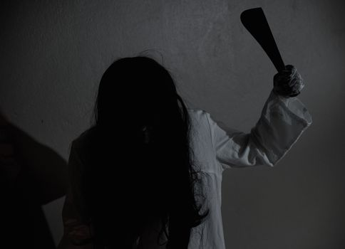 Horror woman ghost creepy holding knife for kill, halloween day concept