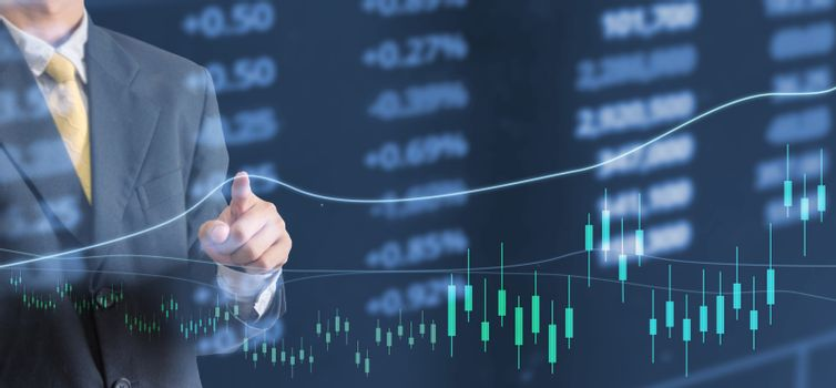 Investment concept business man hand stock graph financial analysis
