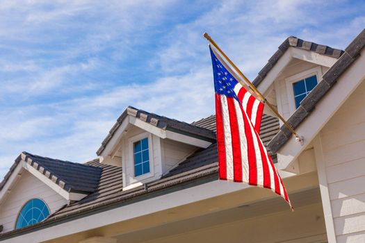 American Flag Hanging From House Facade.