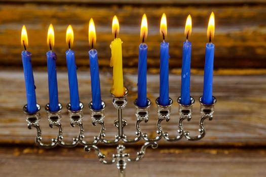 Happy Jewish holiday celebrates Hanukkah menorah festival of lights candles