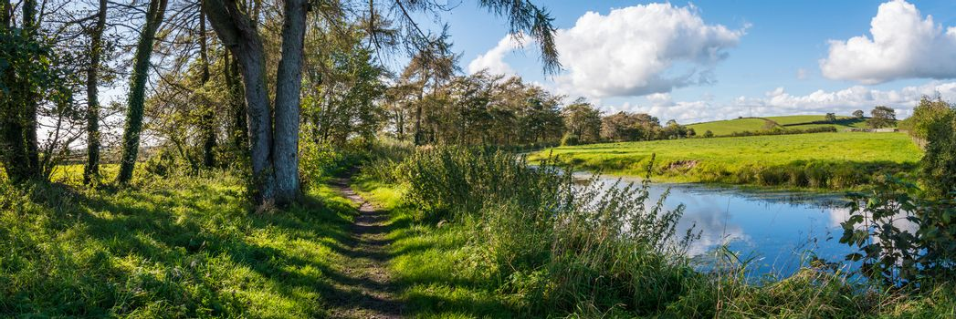 Panaorama of English rural countryside scenery on British waterway canal