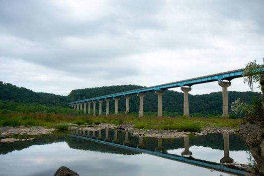 The Norman Wood Bridge OVer the Susquehanna River Reflecting Itself in a Small Body of Water on a Cloudy Day