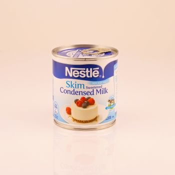 Mackay, Queensland, Australia - February 2020: A tin of skim sweetened condensed milk isolated on a white background, product photography