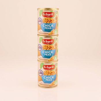 Mackay, Queensland, Australia - February 2020: Three tins of chick peas isolated on a white background, product photography