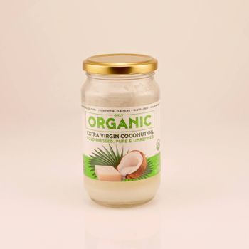 Mackay, Queensland, Australia - February 2020: A bottle of organic coconut oil isolated on a white background, product photography
