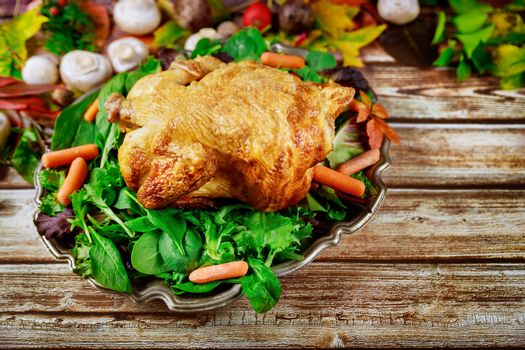 Beautiful traditional Thanksgiving dinner with roasted chicken on autumn background