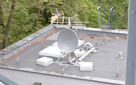 Small white satellite antenna