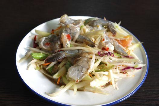 Thai green papaya salad with raw shrimps or Som Tam Thai Gung