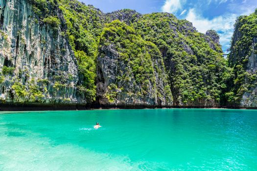 Young man snorkel diving at Phi Phi island in Phuket province, Thailand.
