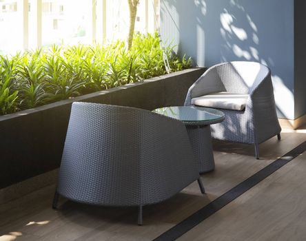 Empty modern chair and table at terrace with light