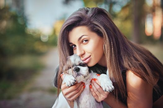Oung woman with her cute Shih Tzu. Lovely pet
