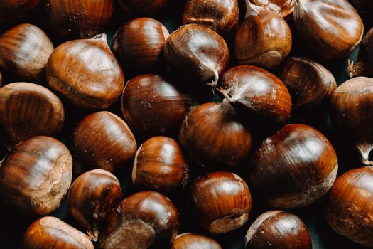 Super close up of a lot of chestnuts with super texture and sharpness with copy space