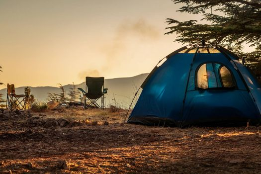 Camping on the Top of the Mountain. Peaceful Recreation in the Nature. Active Lifestyle. Autumn in Campsite.