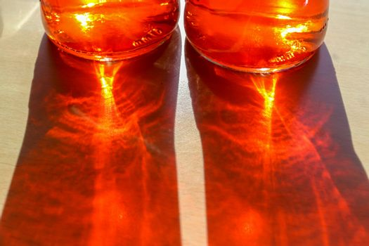 Sunlight shining through a drinking glas showing caustic light e