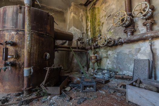Rusty boiler and pipe system in a factory
