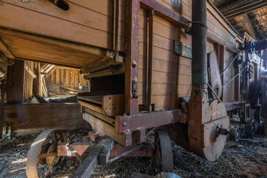old wooden thresher detail view