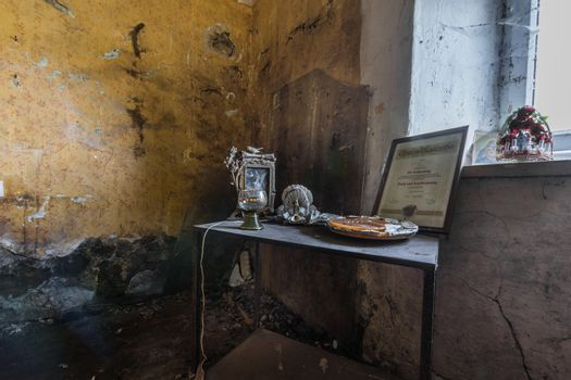 table with nice objects in an abandoned house
