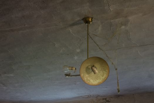 Creative lamp in an old abandoned house