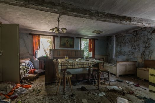 furnished old abandoned house with many objects