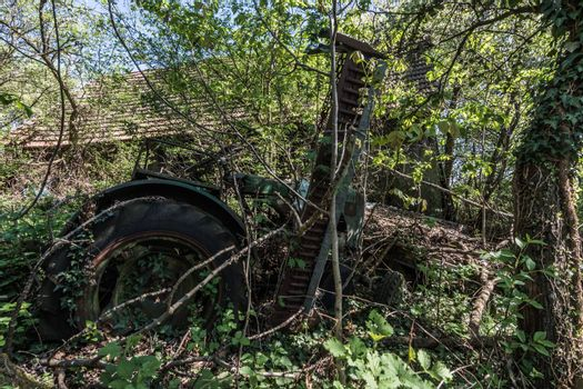 Old decayed tractor on a deserted farm