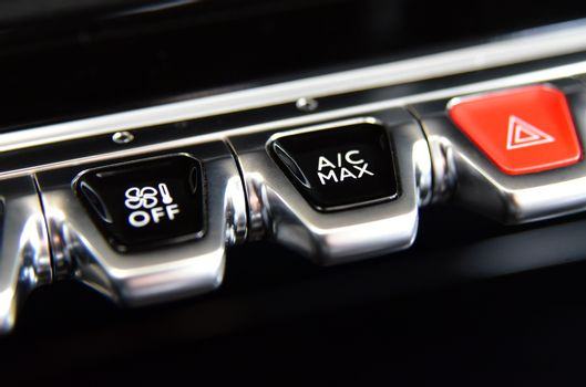 Buttons for activating the air conditioners on the dashboard passenger car