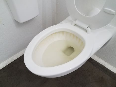dirty and filthy stained bathroom toilet in restroom