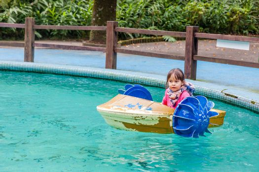 Young girl in hand paddle boat
