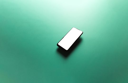 Minimalistic mock up flat image design with a floating mobile phone with copy space and white scree to write over it over a flat green background