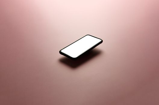 Minimalistic mock up flat image design with a floating mobile phone with copy space and white scree to write over it over a flat pastel pink background
