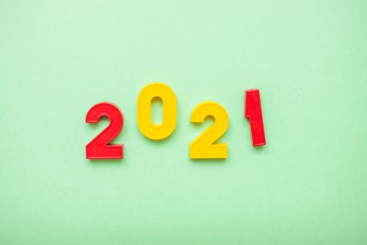 Happy New year 2021 celebration. The inscription 2021 on the green background