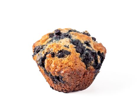 Homemade vegan blueberry muffin isolated. Vegetarian egg-free muffin with blue berries isolated on whte with clipping path.
